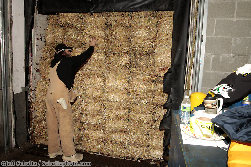 Ed Sundeen prepares to unload some of the1500 bales of straw at Airland Transport in Anchorage to be sent out to the 22 checkpoints along the Iditarod trail Thursday, Feb. 7, 2013.