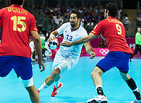 08 AUG 2012 - LONDON, GBR - Nikola Karabatic (FRA) of France (centre) looks for a way through the Spanish defence during the men's London 2012 Olympic Games quarter final match at the Basketball Arena in the Olympic Park, in Stratford, London, Great Britain .(PHOTO (C) 2012 NIGEL FARROW)