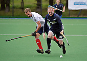 Hockey - Mens Invitational 4 Nations event at Sportscotland National Centre, Largs - Scotland V England - Scotland midfielder Gordon McIntyre shields the ball from England forward Dan Fox - Picture by Donald MacLeod - 13.06.11 - 07702 319 738 - www.donald-macleod.com - clanmacleod@btinternet.com