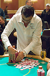 Hachem organizes his chips after winning a big pot