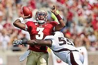 September 03, 2011:  Florida State Seminoles quarterback EJ Manuel (3) throws a pass while being tackled by Louisiana Monroe Warhawks defensive end Troy Evans (55) during 1st half action between the Florida State Seminoles and the Louisiana Monroe Warhawks at Doak S. Campbell Stadium in Tallahassee, Florida.