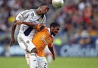 CARSON, CA - DECEMBER 01, 2012:   Edson Buddle (14) of the Los Angeles Galaxy heads over Corey Ashe (26) of the Houston Dynamo during the 2012 MLS Cup at the Home Depot Center, in Carson, California on December 01, 2012. The Galaxy won 3-1.