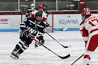 BOSTON, MA - FEBRUARY 16: Nicole Dunbar #4 of University of New Hampshire during a game between University of New Hampshire and Boston University at Walter Brown Arena on February 16, 2020 in Boston, Massachusetts.