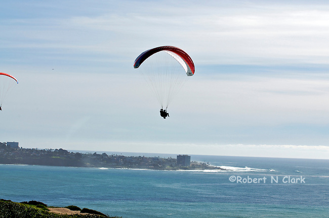 Hang Gliders at Torrey Pines Glider port.  The Glider port is located near the famous Torrey Pines Golf Course, on the bluffs.  It has a spectacular view of the coast and La Jolla Cove to the South