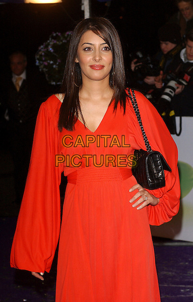 LAILA ROUASS.The British Comedy Awards 2005 at the London ITV Studios, UK..December 14th, 2005.Ref: BEL.half length red dress hand on hip.www.capitalpictures.com.sales@capitalpictures.com.© Capital Pictures.