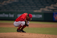 AZL Angels relief pitcher Darrien Williams (28) reflects before taking the mound during an Arizona League game against the AZL Padres 2 at Tempe Diablo Stadium on July 18, 2018 in Tempe, Arizona. The AZL Padres 2 defeated the AZL Angels 8-1. (Zachary Lucy/Four Seam Images)