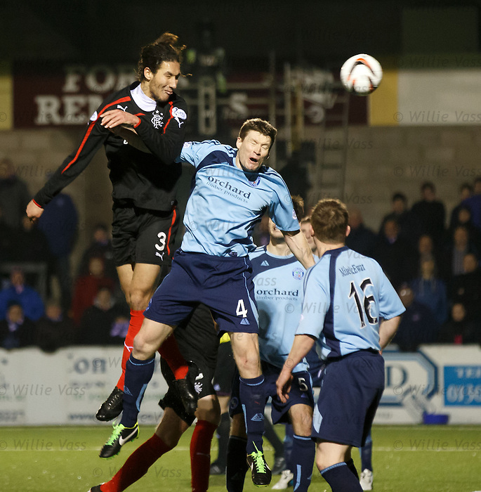 Bilel Mohsni beats Darren Dods in the air to score the opening goal for Rangers
