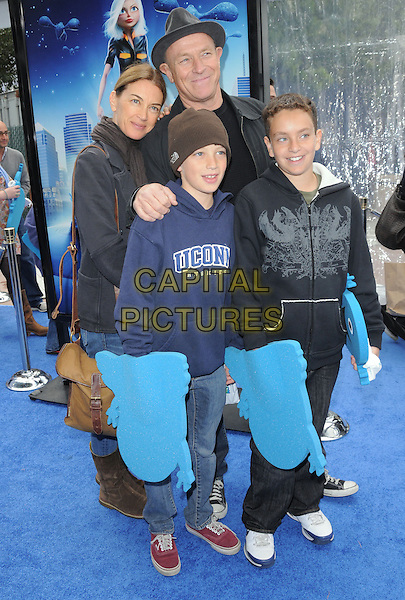 "COBIN BERNSEN & family.""Monsters VS. Aliens"" L.A. Premiere held at Gibson Ampitheatre in Universal City, California, USA..March 22nd, 2009                                                                     full length jeans denim kids children blue black hat.CAP/DVS.©Debbie VanStory/Capital Pictures."