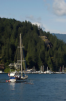 Yacht at anchor with Quarry rock in the background. Deep Cove, Burrard Inlet, Vancouver, British Columbia, Canada.