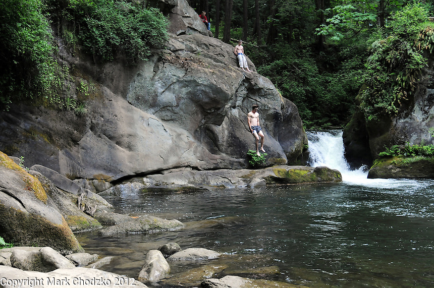 Crazy man jumps from cliffs into freezing water!