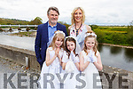 Triple celebrations fro triplets, Ashley, Janina and Delia Doyle from the Listowel Presentation NS as they received their First Holy Communion in St Michaels Church Listowel on Saturday, standing with their mom Diana and dad Aidan.