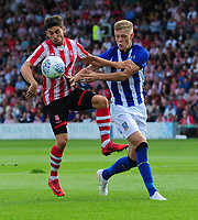 Lincoln City's Tom Pett shields the ball from Sheffield Wednesday's Jack Lee<br /> <br /> Photographer Chris Vaughan/CameraSport<br /> <br /> Football Pre-Season Friendly - Lincoln City v Sheffield Wednesday - Friday 13th July 2018 - Sincil Bank - Lincoln<br /> <br /> World Copyright &copy; 2018 CameraSport. All rights reserved. 43 Linden Ave. Countesthorpe. Leicester. England. LE8 5PG - Tel: +44 (0) 116 277 4147 - admin@camerasport.com - www.camerasport.com