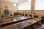Wooden desks in school classroom from early 1900s, Radstock museum, Somerset, England, UK