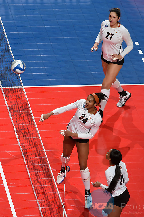 COLUMBUS, OH - DECEMBER 17:  Orie Agbaji (34) of the University of Texas spikes the ball against Stanford University during the Division I Women's Volleyball Championship held at Nationwide Arena on December 17, 2016 in Columbus, Ohio.  Stanford defeated Texas 3-1 to win the national title. (Photo by Jamie Schwaberow/NCAA Photos via Getty Images)