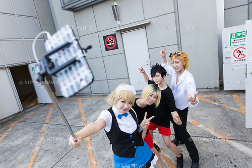Cosplayers pose for a selfie during the Comic Market 90 (Comiket) event in Tokyo Big Sight on August 12, 2016, Tokyo, Japan. Many manga and anime fans wearing cosplay lined up in the sun for the first day of Comiket. Comiket was established in 1975 and focuses on manga, anime, gaming and cosplay. Organizers expect more than 500,000 visitors to attend this year's summer event which runs for three days until August 14. (Photo by Rodrigo Reyes Marin/AFLO)
