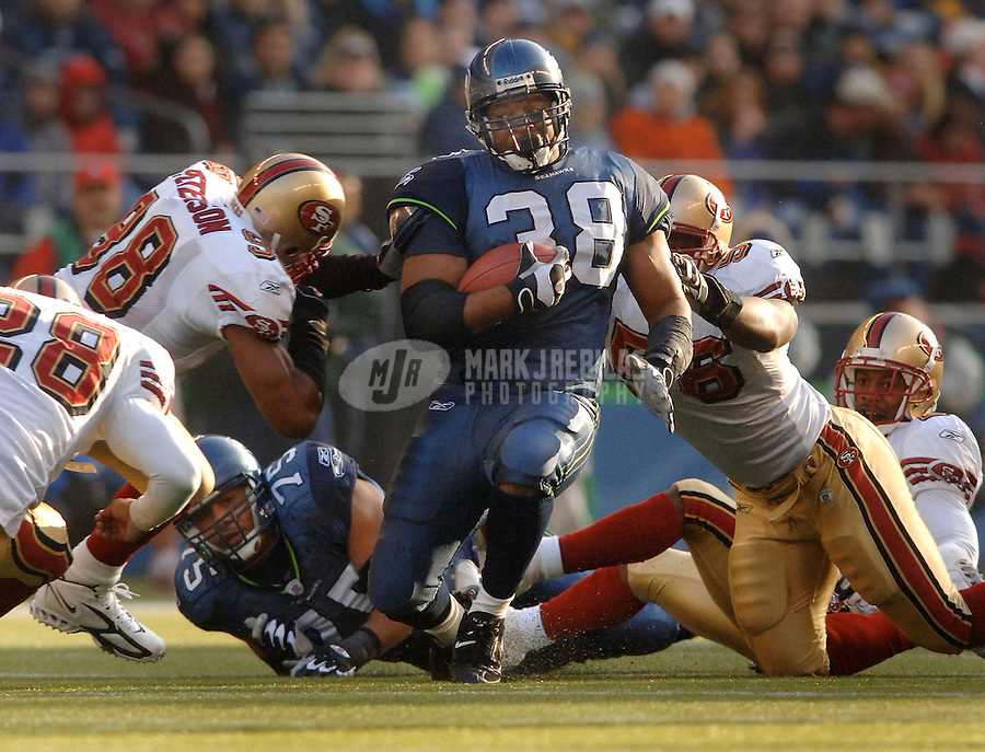 Dec. 11, 2005; Seattle, Wash, USA;  Seattle Seahawks fullback #38 Mack Strong is tackled by San Francisco 49ers defenders in the second quarter at Qwest Field. Mandatory Credit: Photo By Mark J. Rebilas