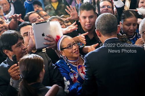 United States President Barack Obama greets members of the audience following his remarks at the 2013 Tribal Nations Conference held at the Department of Interior Building on November 13, 2013 in Washington, DC. <br /> Credit: Kristoffer Tripplaar  / Pool via CNP