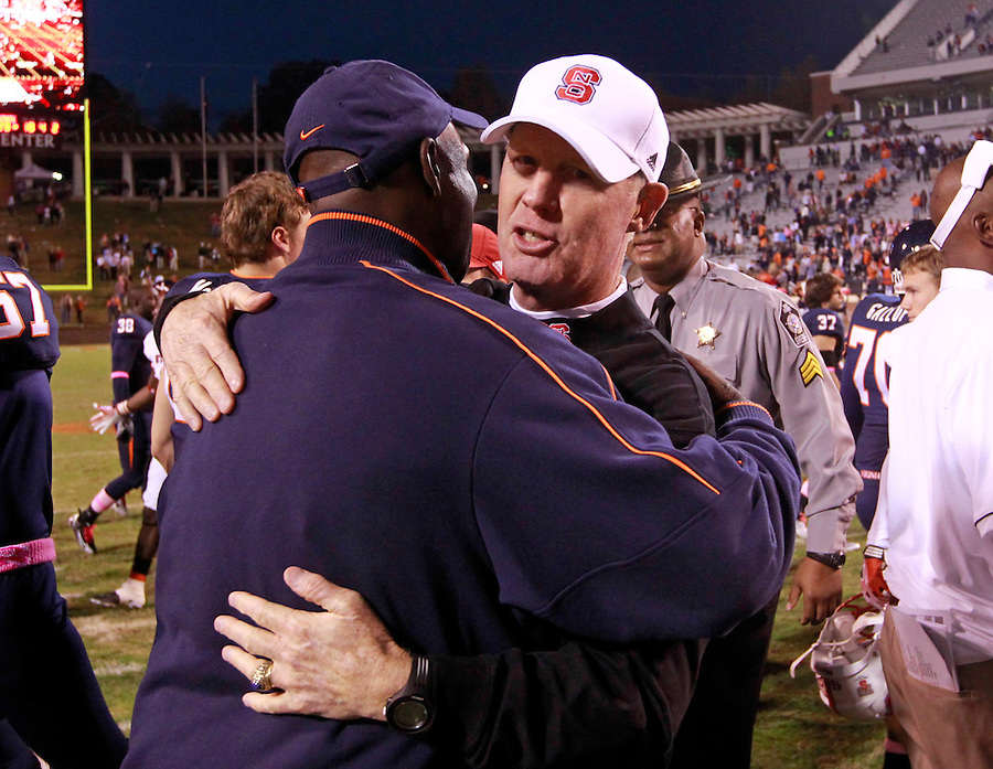 Oct. 22, 2011 - Charlottesville, Virginia - USA; North Carolina State Wolfpack head coach Tom O'Brien receives a hug during an NCAA football game at the Scott Stadium. NC State defeated Virginia 28-14. (Credit Image: © Andrew Shurtleff