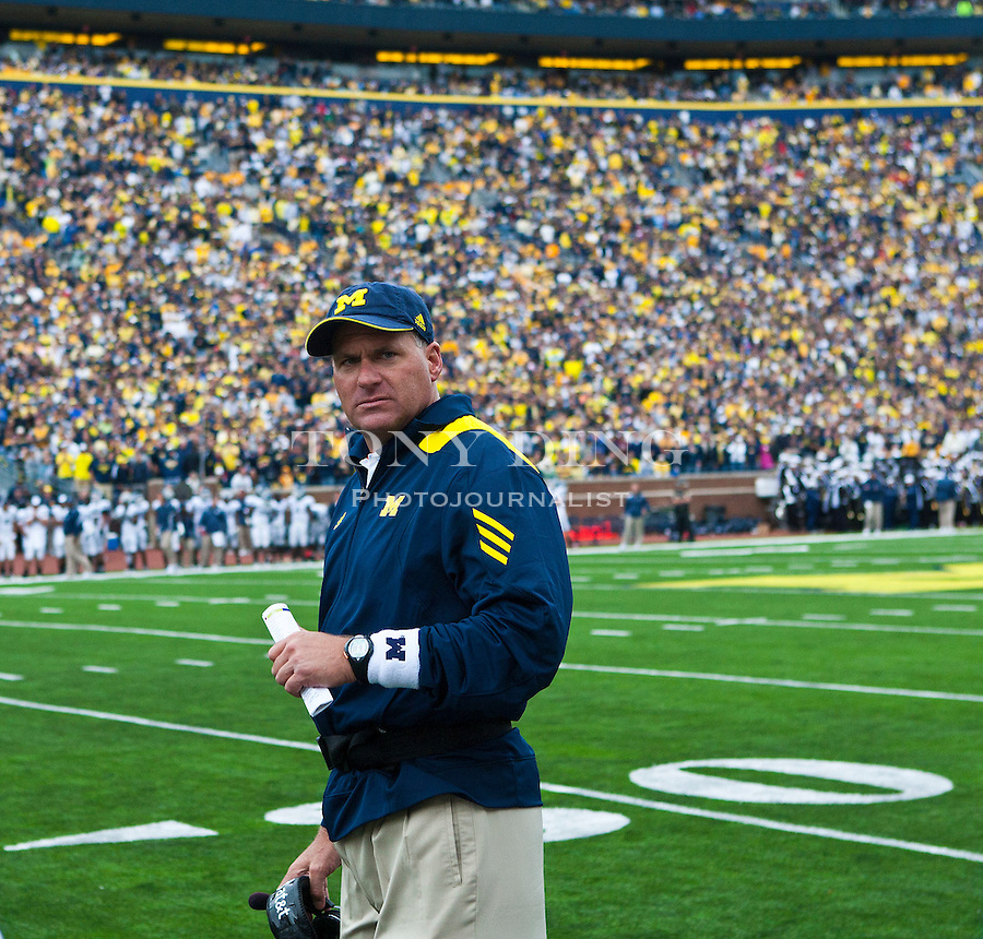 Michigan head coach Rich Rodriguez on the sidelines in the fourth quarter of an NCAA college football game with Connecticut, Saturday, Sept. 4, 2010, in Ann Arbor. Michigan won 30-10. (AP Photo/Tony Ding)