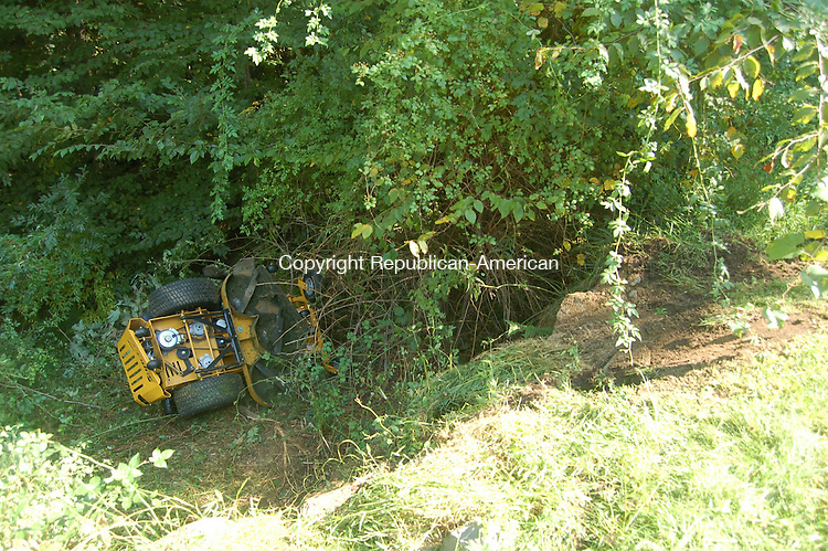 WOODBURY, CT -  24 September 2008 - 092408MO01 - A sitting lawn mower sits at the bottom of a ditch after emergency responders rescued a 61-year-old man who had fallen over and been pinned beneath.