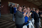 Home fans in the shed applauding striker Lyndon Dykes opening goal at Palmerston Park, Dumfries as Queen of the South hosted Dundee United in a Scottish Championship fixture. The home has played at the same ground since its formation in 1919. Queens won the match 3-0 watched by a crowd of 1,531 spectators.
