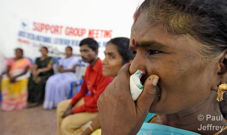 Neelavathi tearfully participates in a support group for HIV positive people at the Gurukul  Lutheran Theological College in Chennai, India. (Note restriction on use in Special Instructions below.)