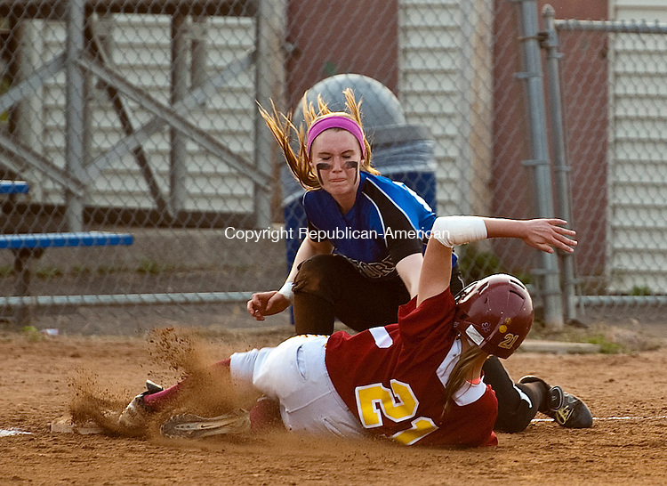STRATFORD, CT--061215JS09-  Oxford's Meghan Sastram (23) tags out St. Joseph's Trish Bestek (21) at third during their Class M state championship game Friday at DeLuca Field in Stratford. <br /> Jim Shannon Republican-American