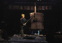 Workers at a workshop in a state cast-steel factory in Tiexi industrial area, Shenyang, northeast China..20-JAN-02