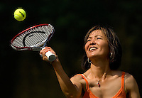 A woman hits a tennis ball at Rolling Hills Country Club in Monroe, NC.