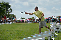 NWA Democrat-Gazette/BEN GOFF @NWABENGOFF<br /> Marcus Talbot of the team 'Deadly Cornadoes' practices his throw Friday, June 16, 2017, during the Catfish, Corndogs and Cornhole tournament at Mercy Hospital in Rogers. The event is an annual fundraiser hosted by WhyteSpyder, whith proceeds from this year's tournament benefiting Mercy Health Foundation. Some 140 teams of two entered this year, according to WhyteSpyder CEO Eric Howerton.