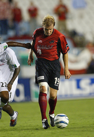 DALLAS, TX AUGUST 11: Bobby Rhine #19 of the Dallas Burn  in action against New England Revolution at Cotton Bowl in Dallas on August 11, 2004 in Dallas, (Photo by Rick Yeatts) Rhine's career consisted of 212 games making 136 starts, played more than 12,000 minutes scoring 23 goals and 34 recorded assists.