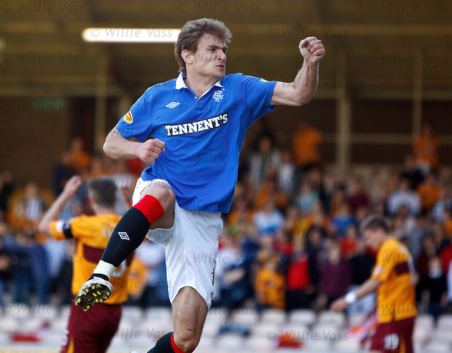 Nikica Jelavic celebrates after scoring goal no 3 for Rangers