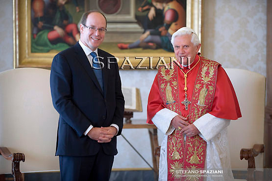 Pope Benedict XVI poses with Prince Albert of Monaco during a private audience in the pontiff's library at the Vatican, Friday, Oct. 16, 2009.