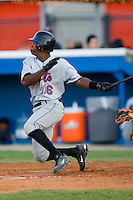 Alonzo Harris #16 of the Kingsport Mets follows through on his swing versus the Burlington Royals at Burlington Athletic Park July 3, 2009 in Burlington, North Carolina. (Photo by Brian Westerholt / Four Seam Images)
