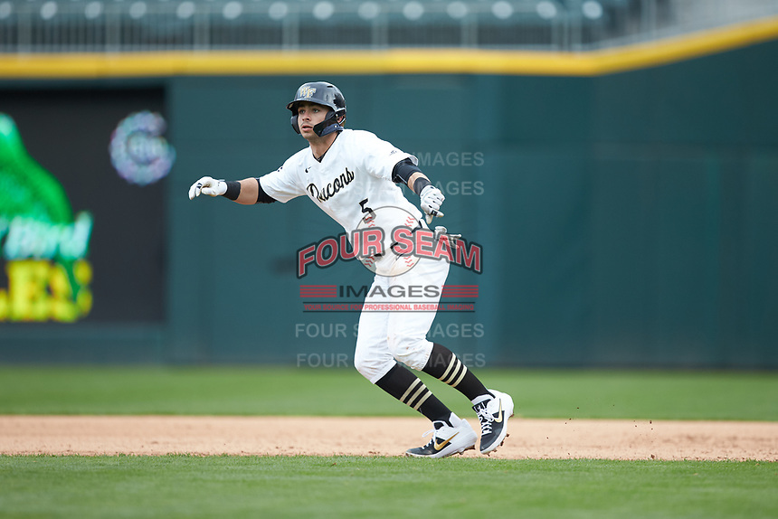 Patrick Frick (5) of the Wake Forest Demon Deacons takes his lead off of first base against the Furman Paladins at BB&T BallPark on March 2, 2019 in Charlotte, North Carolina. The Demon Deacons defeated the Paladins 13-7. (Brian Westerholt/Four Seam Images)