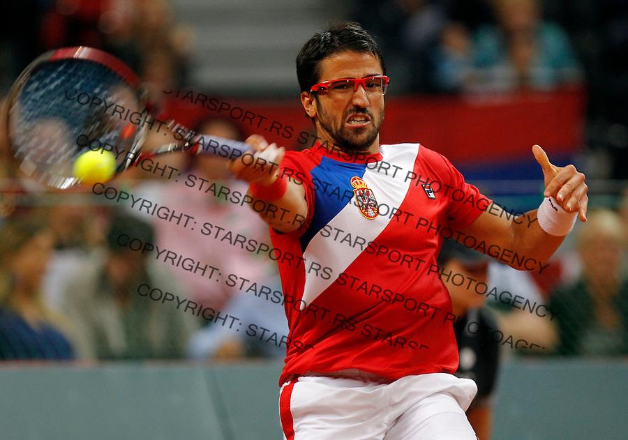Tennis Tenis<br /> Davis Cup semifinal polufinale<br /> Serbia v Canada<br /> Janko Tipsarevic v Milos Raonic<br /> Janko Tipsarevic returnes the ball<br /> Beograd, 13.09.2013.<br /> foto: Srdjan Stevanovic/Starsportphoto &copy;