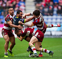 Picture by Alex Whitehead/SWpix.com - 11/03/2018 - Rugby League - Betfred Super League - Wigan Warriors v Wakefield Trinity - DW Stadium, Wigan, England - Wakefield's Bill Tupou is tackled by Wigan's Willie Isa, Tom Davies and John Bateman.