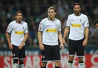 FUSSBALL   1. BUNDESLIGA    SAISON 2012/2013    8. Spieltag   SV Werder Bremen - Borussia Moenchengladbach  07.10.2012 Alvaro Dominguez Soto, Tony Jantschke und Martin Stranzl  (v.l., alle Borussia Moenchengladbach) sind enttaeuscht