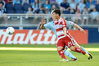 Bryan Leyva (21) FC Dallas midfielder closely marked by Set Sinovic Sporting KC defender... Sporting KC defeated FC Dallas 2-1 at LIVESTRONG Sporting Park, Kansas City, Kansas.