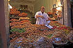 Merchant selling dates, olives and dried fruit in the medina, Marrakech, Morocco, north Africa