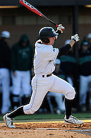 Designated hitter Stephen Dowling (7) of the University of South Carolina Upstate Spartans bats in a game against the UNC Asheville Bulldogs on Tuesday, March, 25, 2014, at Cleveland S. Harley Park in Spartanburg, South Carolina. (Tom Priddy/Four Seam Images)