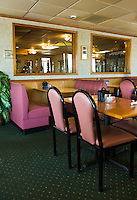 Pink and black chairs in restaurant diner.