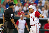 North Carolina State Wolfpack head coach Elliott Avent (9) argues with home plate umpire Joe Burelson (13) during Game 10 of the 2013 Men's College World Series against the North Carolina Tar Heels on June 20, 2013 at TD Ameritrade Park in Omaha, Nebraska. The Tar Heels defeated the Wolfpack 7-0, eliminating North Carolina State from the tournament. (Andrew Woolley/Four Seam Images)