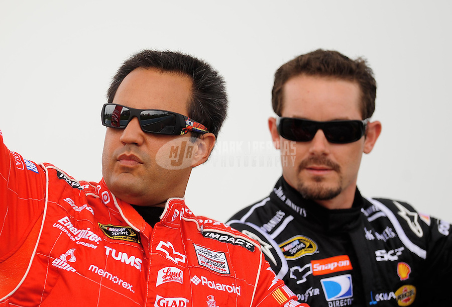 Aug. 10, 2009; Watkins Glen, NY, USA; NASCAR Sprint Cup Series driver Juan Pablo Montoya (left) and Casey Mears prior to the Heluva Good at the Glen at Watkins Glen International. Mandatory Credit: Mark J. Rebilas-