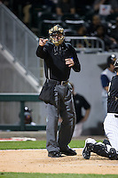 Home plate umpire Matt McCoy makes a strike call during the International League game between the Toledo Mud Hens and the Charlotte Knights at BB&T BallPark on April 27, 2015 in Charlotte, North Carolina.  The Knights defeated the Mud Hens 7-6 in 10 innings.   (Brian Westerholt/Four Seam Images)