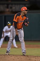 AZL Giants Orange relief pitcher Jorge Labrador (86) looks to his catcher for the sign during an Arizona League game against the AZL Athletics at Lew Wolff Training Complex on June 25, 2018 in Mesa, Arizona. AZL Giants Orange defeated the AZL Athletics 7-5. (Zachary Lucy/Four Seam Images)