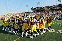 July 25, 2008; Hamilton, ON, CAN;  Hamilton Tiger-Cats pre-game huddle at center field. CFL football - Edmonton Eskimos versus Hamilton Tiger-Cats at Ivor Wynne Stadium. The Eskimos defeated the Tiger-Cats 19-13. Mandatory Credit: Ron Scheffler-ronscheffler.com. Copyright (c) Ron Scheffler