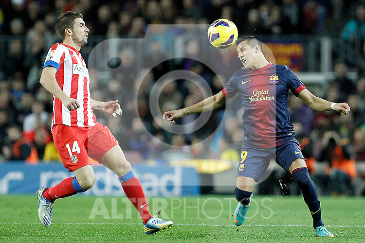 FC Barcelona's Alexis Sanchez (r) and Atletico de Madrid's Gabi Fernandez during La Liga match.December 16,2012. (ALTERPHOTOS/Acero)