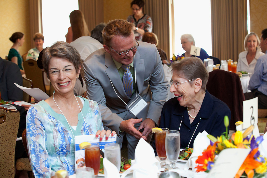 Gold honoree LaVerne Gordan, right, is greeted by Martin Kleffner, n4a, middle, as she sits beside Barbaranne Zem, left, at the Older Volunteers Enrich America Awards at the Double Tree Hotel in Washington, DC on Friday, June 17, 2011.