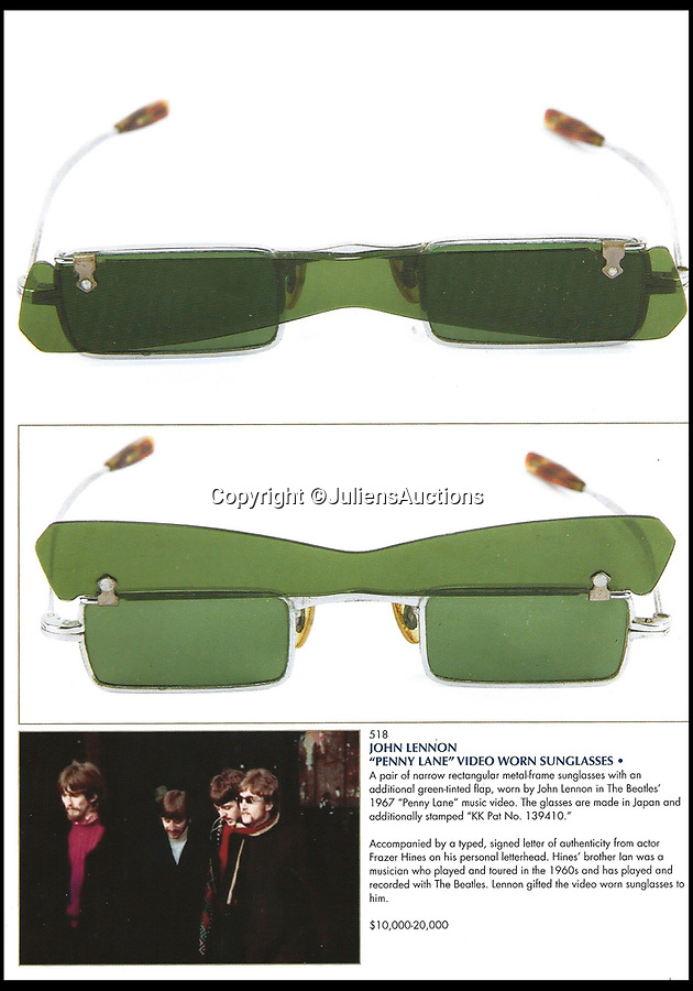 BNPS.co.uk (01202 558833)<br /> Pic:  JuliensAuctions/BNPS<br /> <br /> John Lennon's distinctive green sunglasses from the 'Penny Lane' video have emerged for sale for £15,000.<br /> <br /> The Beatles star wore the narrow rectangular metal frame sunglasses, which also have a green-tinted flap, in the 1967 video.<br /> <br /> At the beginning of the video, Lennon is handed the sunglasses by Paul McCartney and then puts them on, with the camera doing a close-up of his eye-wear.<br /> <br /> They are being sold by former Emmerdale star Frazer Hines, whose musician brother Ian toured and recorded with the Fab Four in the 1960s.